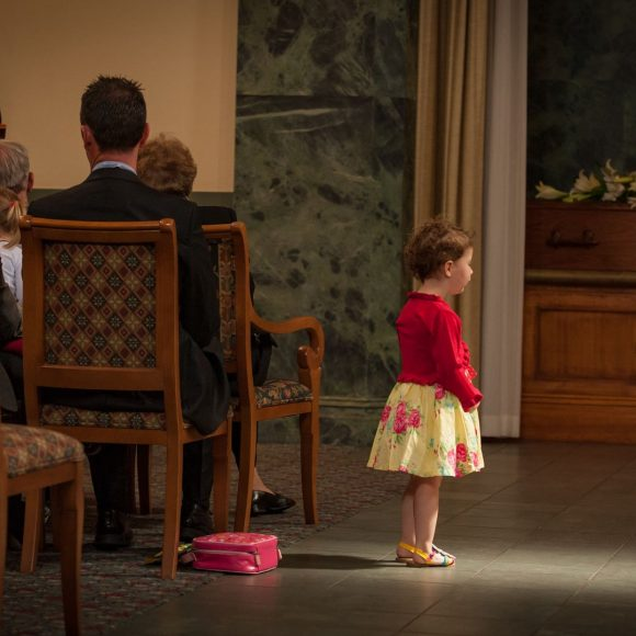 little girl at funeral service