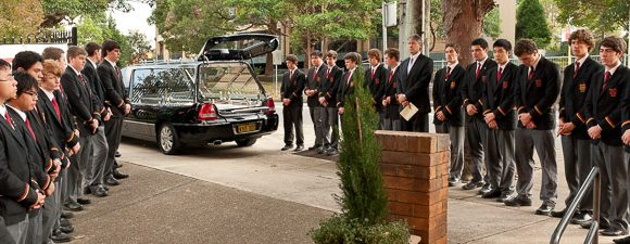 A school honour guard at a Catholic funeral, Lindfield