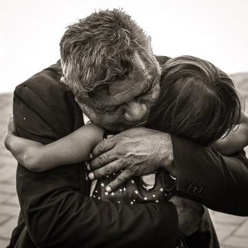 hugging grandchild at funeral